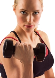black dumbbell in hand of working out blonde female